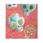 Cráneos coloridos del azúcar blocs de papel
