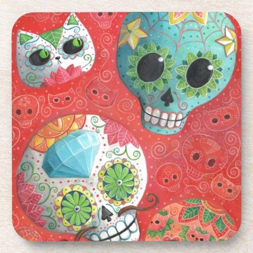 Cráneos coloridos del azúcar posavaso