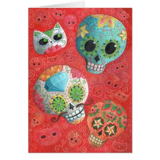 Cráneos coloridos del azúcar tarjeton