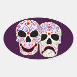Cráneos de la Comedia-Tragedia de Halloween DOTD Pegatina Ovalada