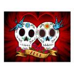 Cráneos del amor con la postal de los Bluebirds