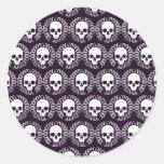 Cráneos del vintage púrpuras y blancos pegatinas redondas