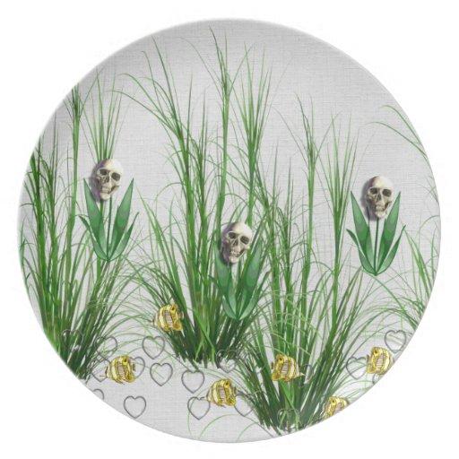 Cráneos en las malas hierbas plato de comida
