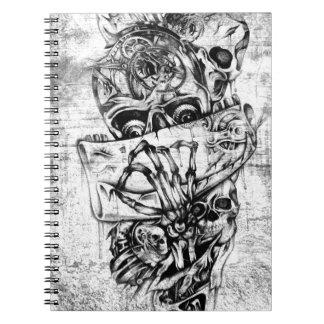 Cráneos punkyes del vapor en base gris del grunge cuaderno