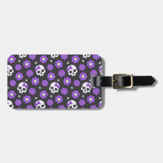 Cráneos y flores violetas etiquetas maleta