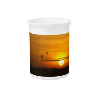Cranes at sunrise beverage pitcher