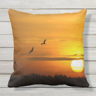 Cranes at sunrise outdoor pillow