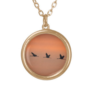 Cranes at sunrise round pendant necklace
