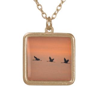 Cranes at sunrise square pendant necklace