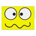 Crazy insane smiley face cross eyed card