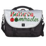 Crea en milagros bolsas de portatil