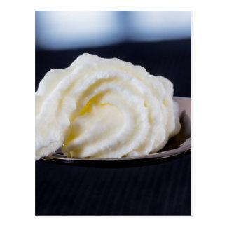 cream on a spoon macro concept postcard