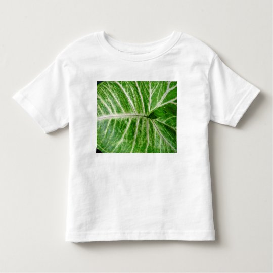 Cream patterns on green leaf toddler t-shirt