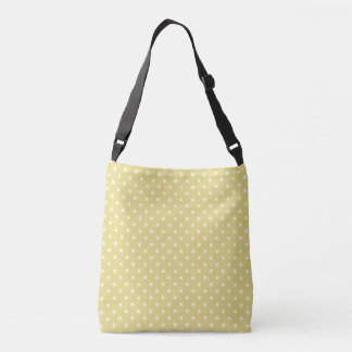 Cream polka dots design on green crossbody bag