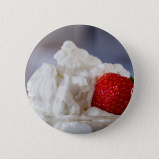 Cream with strawberries in a glass bowl button