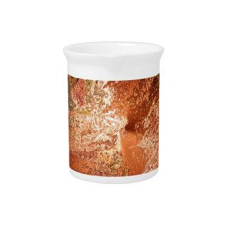 creamy colors, bronze drink pitcher