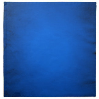 Creased blue paper with spotlight cloth napkin