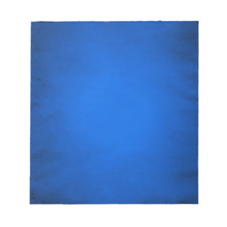 Creased blue paper with spotlight notepad