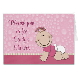 a cute baby in a bright pink shirt and diaper crawls on a pink carpet against a raindrop background in these cute greeting card baby shower