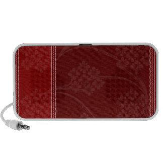 Creative floral design on dark red background travelling speaker