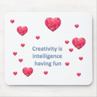 Creativity is  intelligence  having fun mouse pad