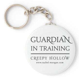 "Creepy Hollow ""guardian in training"" keychain"