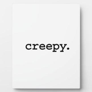 creepy. photo plaques