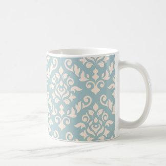 Crema barroca del modelo del damasco en azul taza