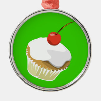 Creme cupcake with cherry ornament