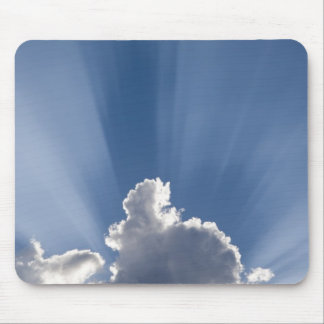Crepuscular or God's rays streak past cloud. Mouse Pad