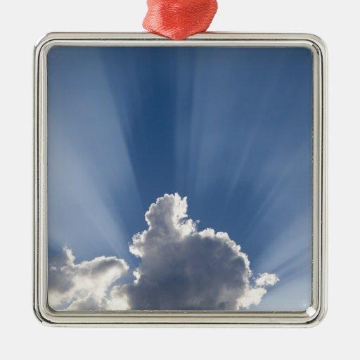 Crepuscular or God's rays streak past cloud. Ornament