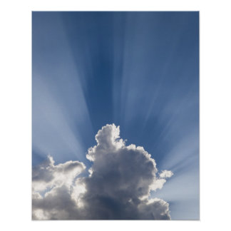 Crepuscular or God's rays streak past cloud. Poster