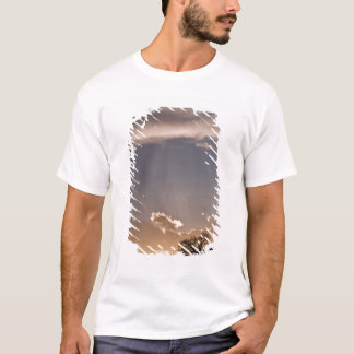 Crepuscular rays radiate across the sky at T-Shirt