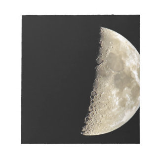 Crescent moon on black background notepad