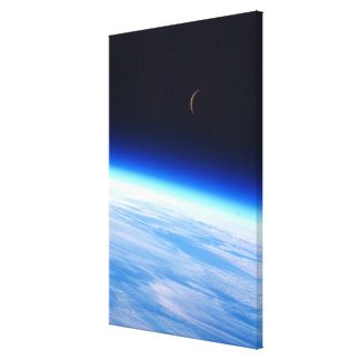 Crescent Moon Over A Bright Blue Glowing Earth Gallery Wrap Canvas