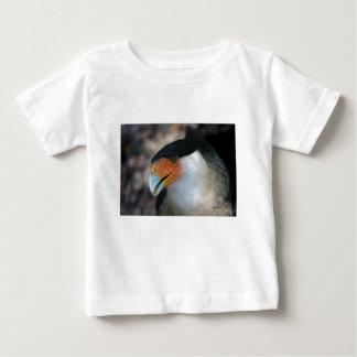 Crested Caracara hawk looking up at camera Baby T-Shirt