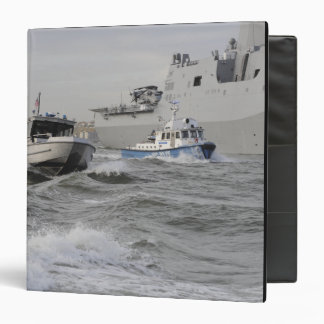 Crews from the coast guard and police departmen binder