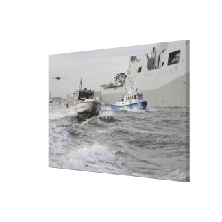 Crews from the coast guard and police departmen canvas print