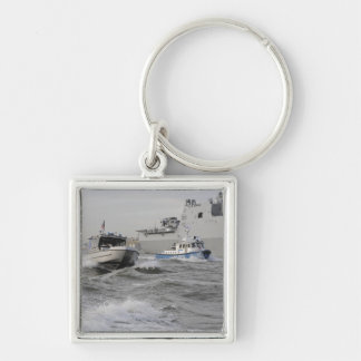 Crews from the coast guard and police departmen keychain