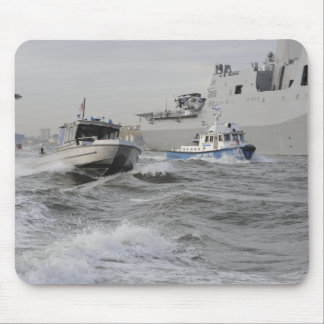 Crews from the coast guard and police departmen mouse pad