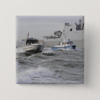 Crews from the coast guard and police departmen pinback button