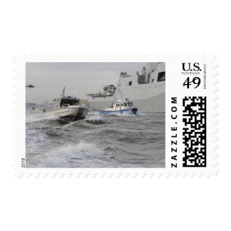Crews from the coast guard and police departmen postage
