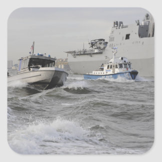 Crews from the coast guard and police departmen square sticker