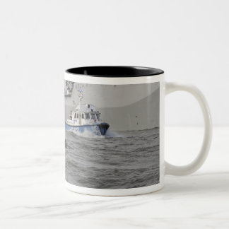 Crews from the coast guard and police departmen Two-Tone coffee mug