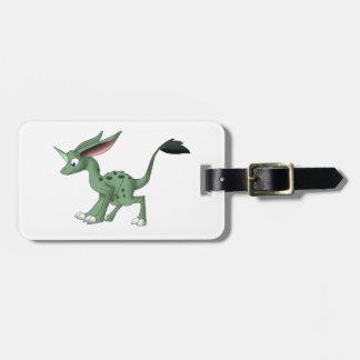 Criatura indefinida con el cuerno del unicornio etiquetas maletas