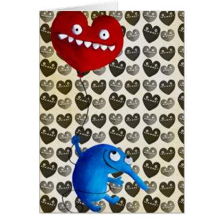 Criatura linda azul con el globo del corazón tarjeton