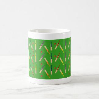 Cricket bats/ balls with green background Mug