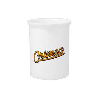 Crimea in orange drink pitchers