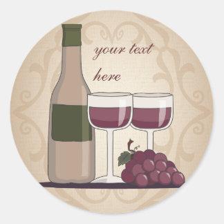 Cristales y uvas de botellas de vino rojo del pegatina redonda