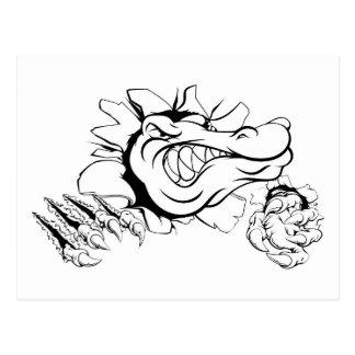 Crocodile or alligator smashing through wall postcard